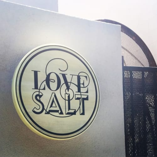 Signage by Leaf Cutter Studio seen at Love & Salt, Manhattan Beach - Glowing Hand Painted Sign