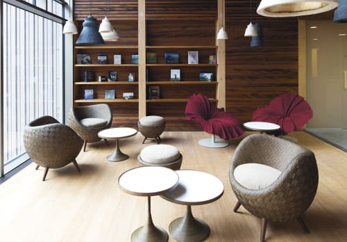 Chairs by Kenneth Cobonpue at Seehotel Wilerbad Seminar & Spa Switzerland, Sarnen - La Luna Easy Armchair and Ottoman, Luna Occasional Table