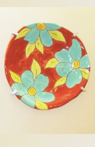 Tableware by Sally Russell seen at Community Hospital of the Monterey Peninsula, Monterey - Built in Platters Red, Sky Blue, and Green