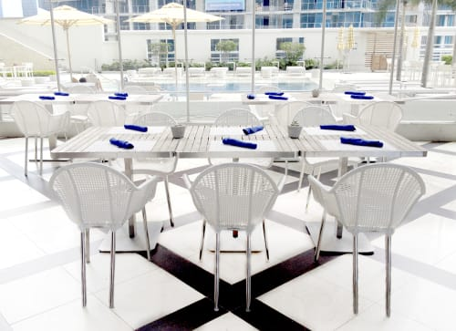 Chairs by Kenneth Cobonpue seen at Trump International Hotel & Tower Panama, Panama City - Marcel Armchair