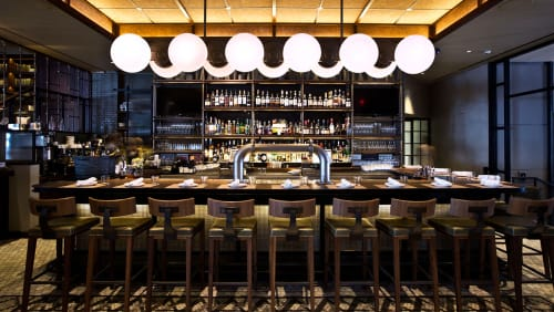 Lighting by CRÈME Design seen at The Vine, New York - Sculptural Brushed Nickel Light