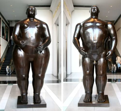 Sculptures by Fernando Botero seen at The Shops at Columbus Circle, New York - Adam and Eve