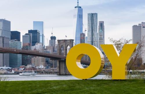 Public Sculptures by Deborah Kass seen at Brooklyn Bridge Park, Brooklyn - OY