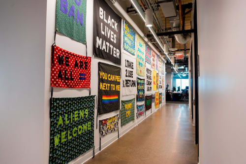 "Wall Hangings by Aram Han Sifuentes seen at Facebook Chicago, Chicago - ""Protest Banner Lending Library"""
