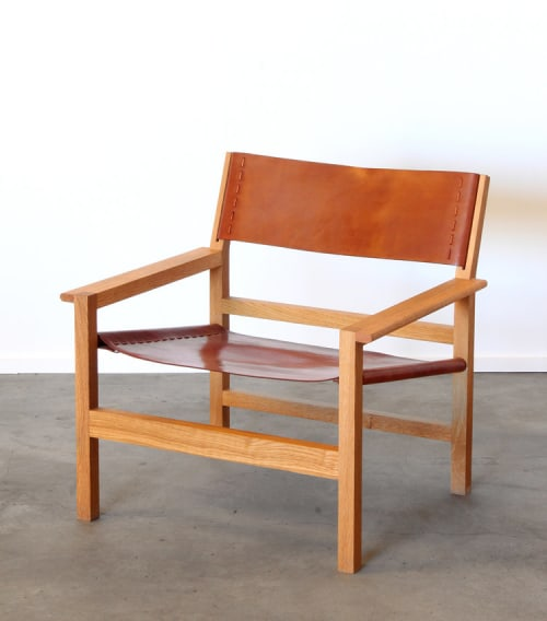 Chairs by Fire On The Mesa seen at The Joshua Tree Hacienda, Joshua Tree - Boyd Oak Lounge Chair with Tan Leather