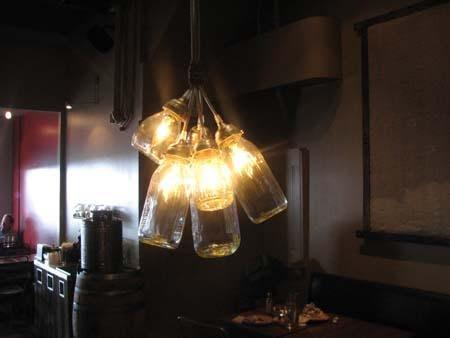 Chandeliers by Metro Lighting seen at Roam Artisan Burgers, San Francisco - Custom Strauss Milk Bottle Chandelier