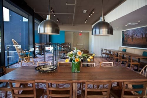 Tables by Rios Clementi Hale Studios seen at Cafe Gratitude Larchmont, Los Angeles - Natural Wood Communal Table