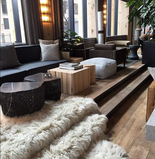 Tables by Fernando Mastrangelo seen at 1 Hotel Brooklyn Bridge, Brooklyn - Cast Black Silica Table