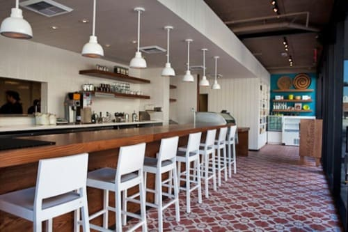 Furniture by Rios Clementi Hale Studios seen at Cafe Gratitude Larchmont, Los Angeles - Natural Wood Bar Top