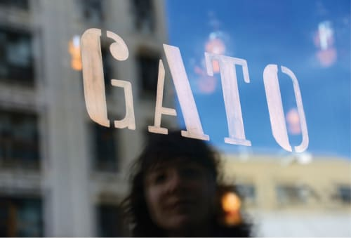 Signage by okMitch Studio seen at GATO, New York - Logo on the restaurant windows
