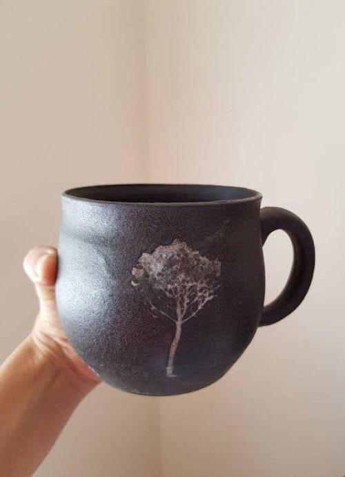Cups by ShellyClayspot seen at Creator's Studio, Kiryat Gat - Black Ceramic Tree Mug