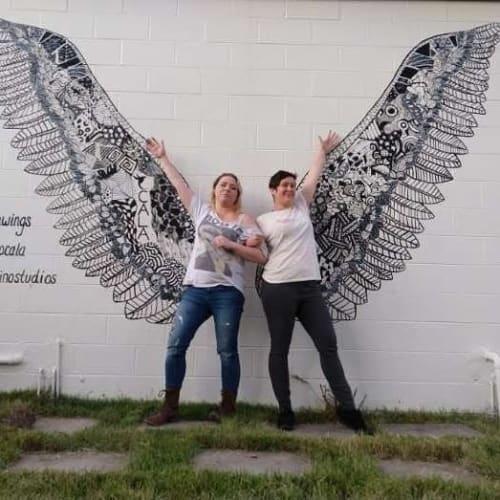 Murals by Mel Fiorentino Studios seen at ONE Hot Yoga, Ocala - Wings Mural