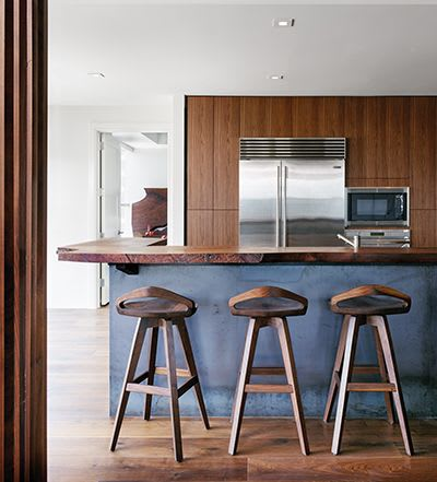 Chairs by Marco Bogazzi seen at Private Residence, Austin - Tractor Seat Stools