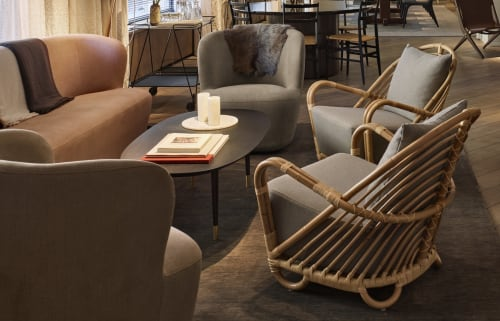 Chairs by Arne Jacobsen at 11 Howard, New York - Charlottenborg Rattan Chair