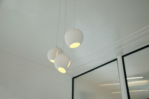 Lighting by Peter St. Lawrence seen at KronnerBurger, Oakland - Custom Translucent Porcelain Globe Pendant Lights