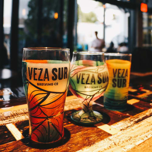 Signage by David Lavernia seen at Veza Sur Brewing Co., Miami - Hand-Painted Beer Glasses