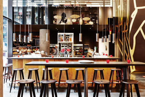 Chairs by Jean Prouvé seen at citizenM New York, New York - Tabouret Haut Bar Stool