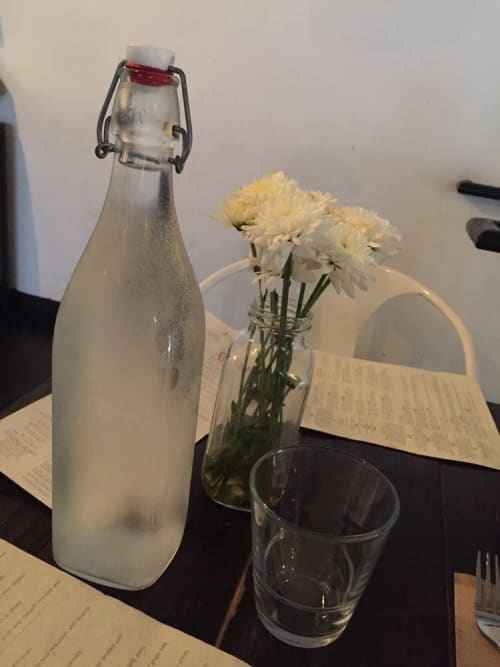 Tableware by Spokenglass seen at Sage Vegan Bistro - Echo Park, Los Angeles - Custom Engraved Bottles