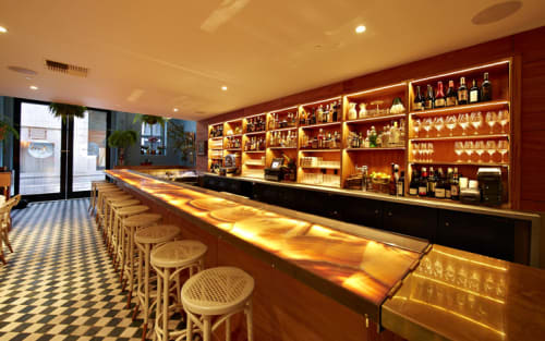 Tables by Ken Fulk seen at Leo's Oyster Bar, San Francisco - Glowing Onyx Bar Top