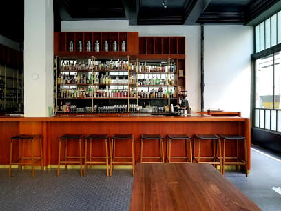 Chairs by Fyrn seen at The Cordial, San Francisco - Bartlett Backless Bar Stool