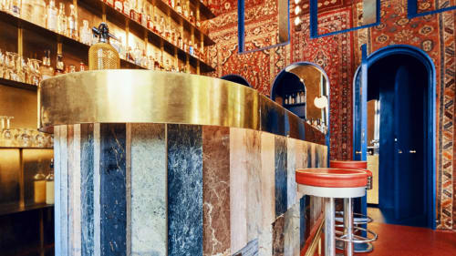 Interior Design by Kacper Gronkiewicz seen at Aura, Warszawa - Heavy Patterned Carpets and Brass Fixtures