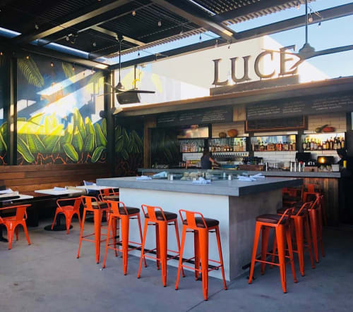Chairs by DC Custom Concrete seen at Luce Bar & Kitchen, San Diego - Concrete bars chairs