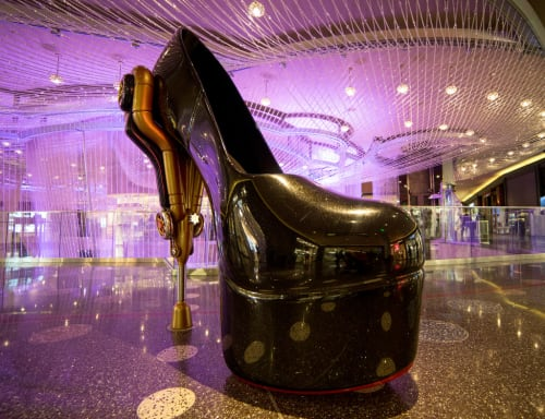 "Sculptures by Roark Gourley seen at The Cosmopolitan of Las Vegas, Las Vegas - ""Fit to be Tied"" and ""Steam Pump"" - The Big Shoes"