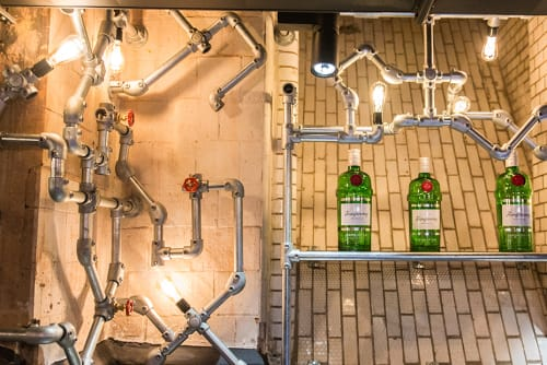 Lighting by Blom & Blom at Generator Hostel, Amsterdam - Labyrinth of Pipes, Valves, and Lights