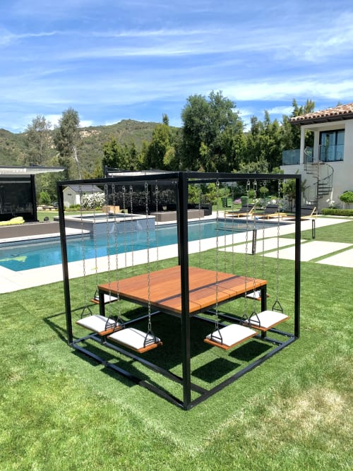 Tables by SwingTables seen at Kevin Hart's Home, Calabasas - Kevin Hart's Black 8-Seater SwingTable Teak