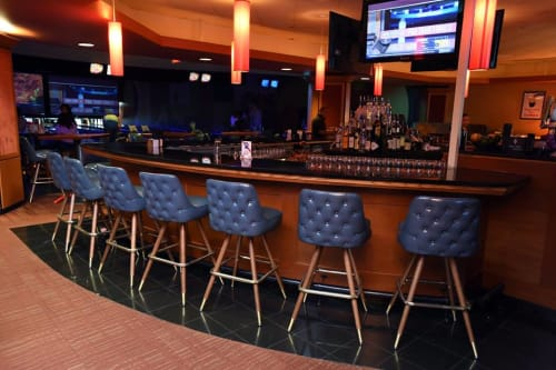Chairs by Richardson Seating Corporation seen at 10pin Bowling Lounge, Chicago - Button Tufted Bar Stools