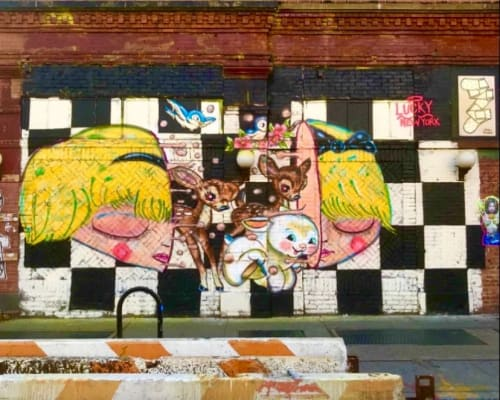 """Murals by Lucky Rabbit seen at Bowery & East Houston Street, New York - Alice """" It's no use going back to yesterday, because I was a different person then."""" Lewis Carrol"""