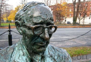Public Sculptures by John Coll Sculpture seen at Mespil Road, Dublin - Paddy Kavanagh