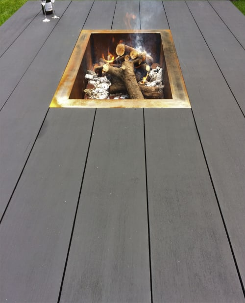 Tables by Craft-B seen at Private Residence, Brecht - Low, XXL outdoor table with open fire pit.