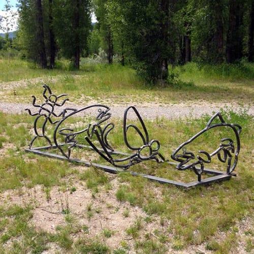 Public Sculptures by Ben Roth Design seen at Rendezvous Park, Wilson - Trout & Bug Bike Racks