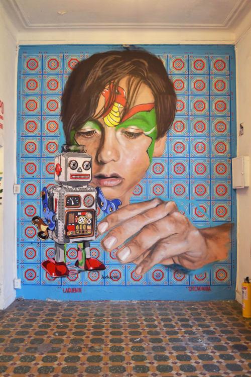 Murals by Chicadania seen at Visaje Galería, Bogotá - Marc playing