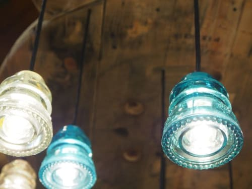 Chandeliers by RailroadWare Lighting & Hardware seen at KEEN Garage, Portland - Insulator Light Pendant Chandelier