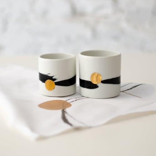 Cups by Boya Porcelain seen at Creator's Studio, Beograd - Nami minimalistic cup, white w/ black brush stroke & golden