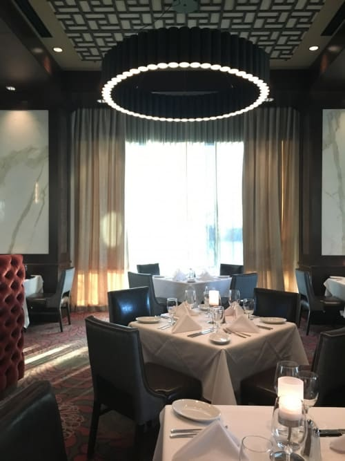 Pendants by ILEX Architectural Lighting seen at Ruth's Chris Steak House, Tulsa - Custom Pendant