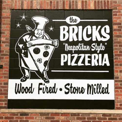 Street Murals by Motown Sign Co. seen at The Bricks, Grosse Pointe Park - pizza man!