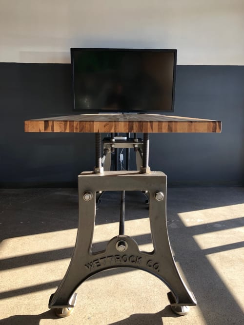 Tables by Wettrock Co. seen at Private Residence, Edina - Vintage Industrial Cast Iron Legs and Maple Top Bar Height