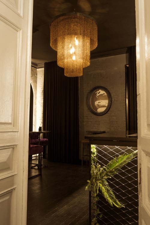 Chandeliers by Pleiades lighting seen at Anna Mesha, Naktinis Klubas, Naktinis Miestas, Kaunas - Small chain chandelier