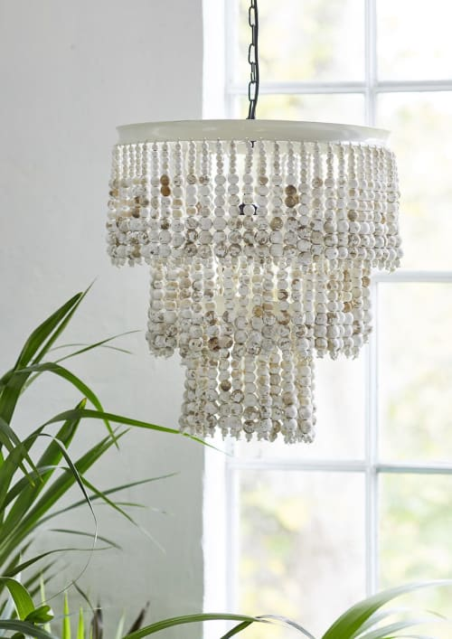 Lamps by liv interior seen at Private Residence, Hamburg - Chandelier with wooden pearls