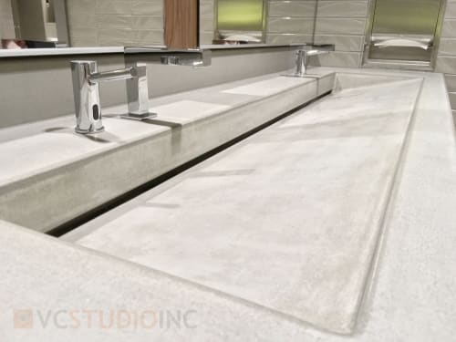 Water Fixtures by VC Studio Inc. seen at Lincoln Square South (Lincoln Square Expansion), Bellevue - Custom Madison ramp style concrete sink.