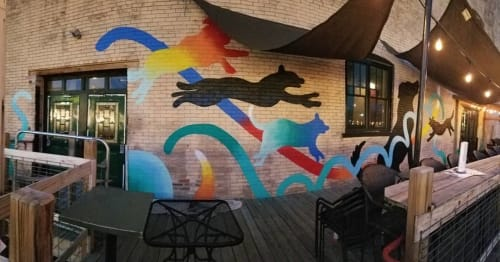 Murals by Bonus Saves (Patrick Hershberger) seen at Old Dog Tavern, Kalamazoo - Jumping Dogs and Treehouse Mural