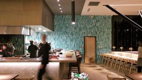Tiles by Mervyn Gers Ceramics seen at Marble Restaurant, Johannesburg - Handmade Tiles