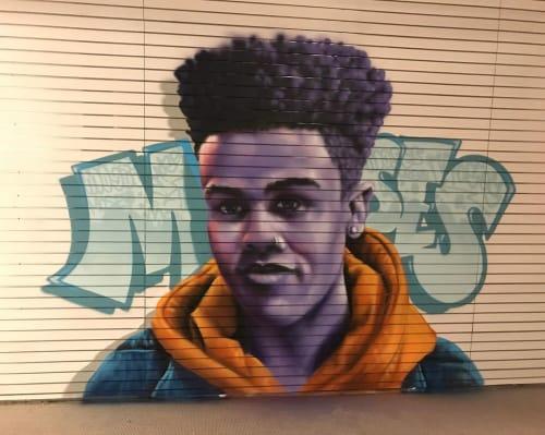Murals by AJA Louden seen at Kingsway Mall, Edmonton - Moses mural