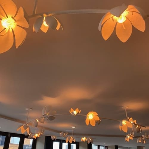 Pendants by Anna Charlesworth seen at Laurent Bakery, Kew - Flower Arc lights
