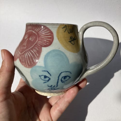 Cups by Muddythings by Mayon Hanania seen at Marida- Jewelry and Gifts, Long Beach - Multicolor Skull flowers and faces mug