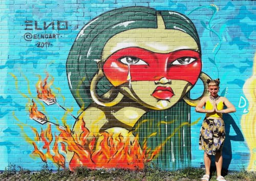 Street Murals by ELNO seen at Nomadic Community Garden, London - Amazonian Woman Mural
