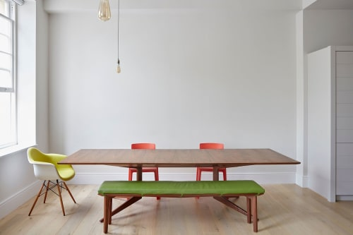 Tables by Young & Norgate seen at Private Residence, Saint Paul's - Solid Walnut extendable dining table with upholstered bench seating